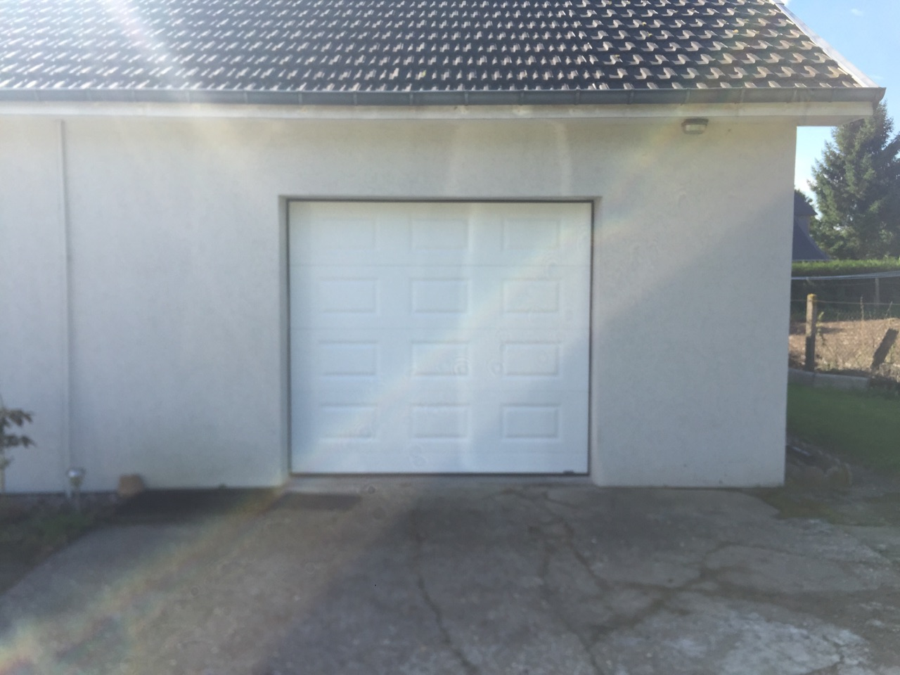 Rénovation d'une porte de garage sectionnelle