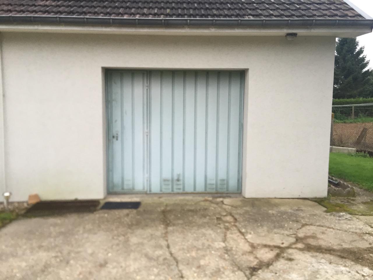 R novation d 39 une porte de garage sectionnelle - Porte de renovation ...