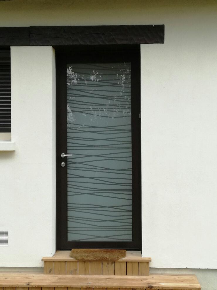 Remplacement d'une porte d'entrée au Neubourg dans l'Eure