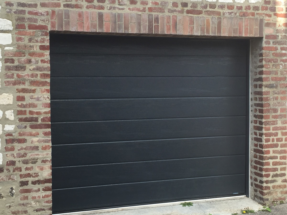 Remplacement d'une porte de garage sectionnelle